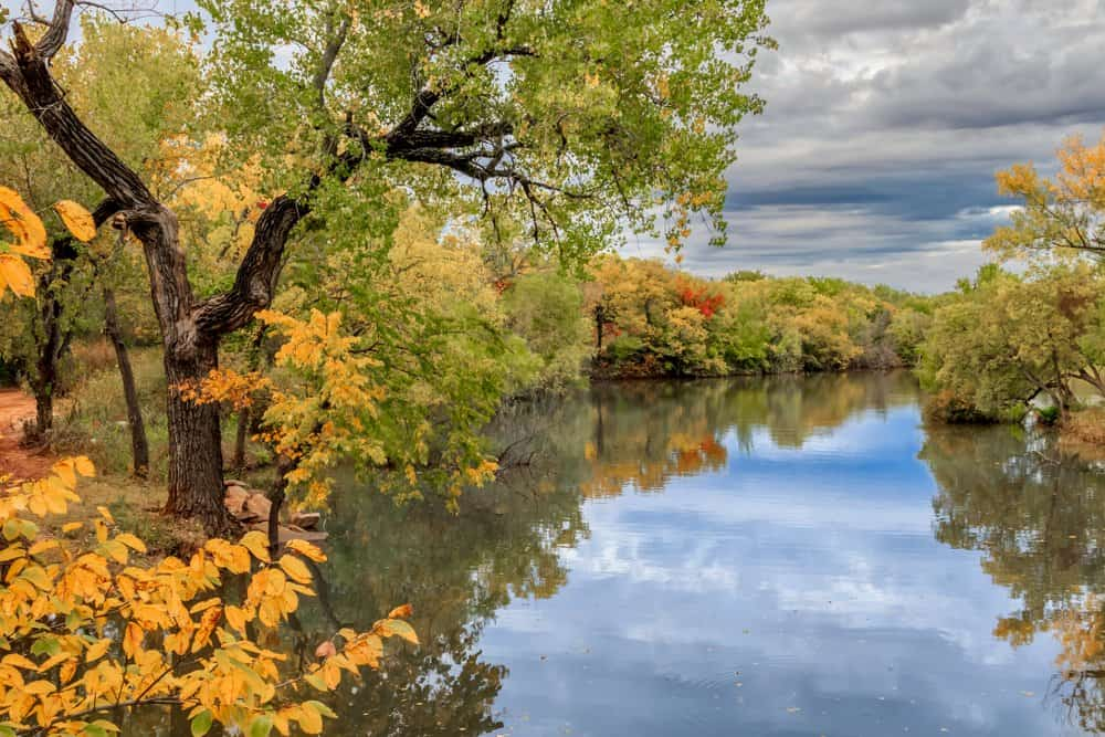 USA - Oklahoma - Oklahoma City's Lake Hefner surrounded by trees in fall color