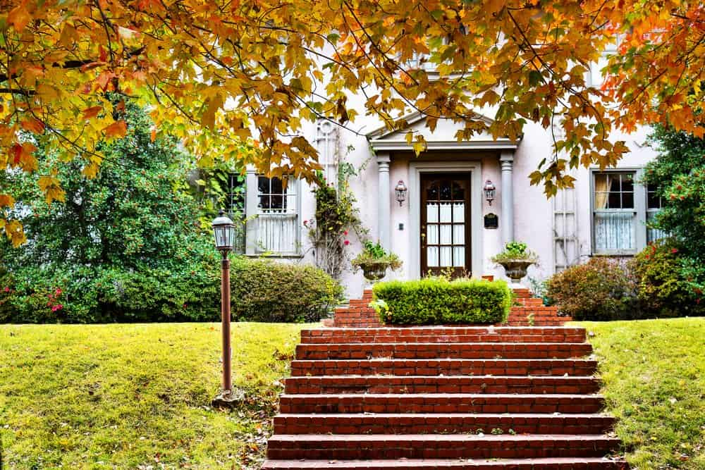 USA - Oklahoma - Curb Appeal - Charming home with red brick steps and fall foliage