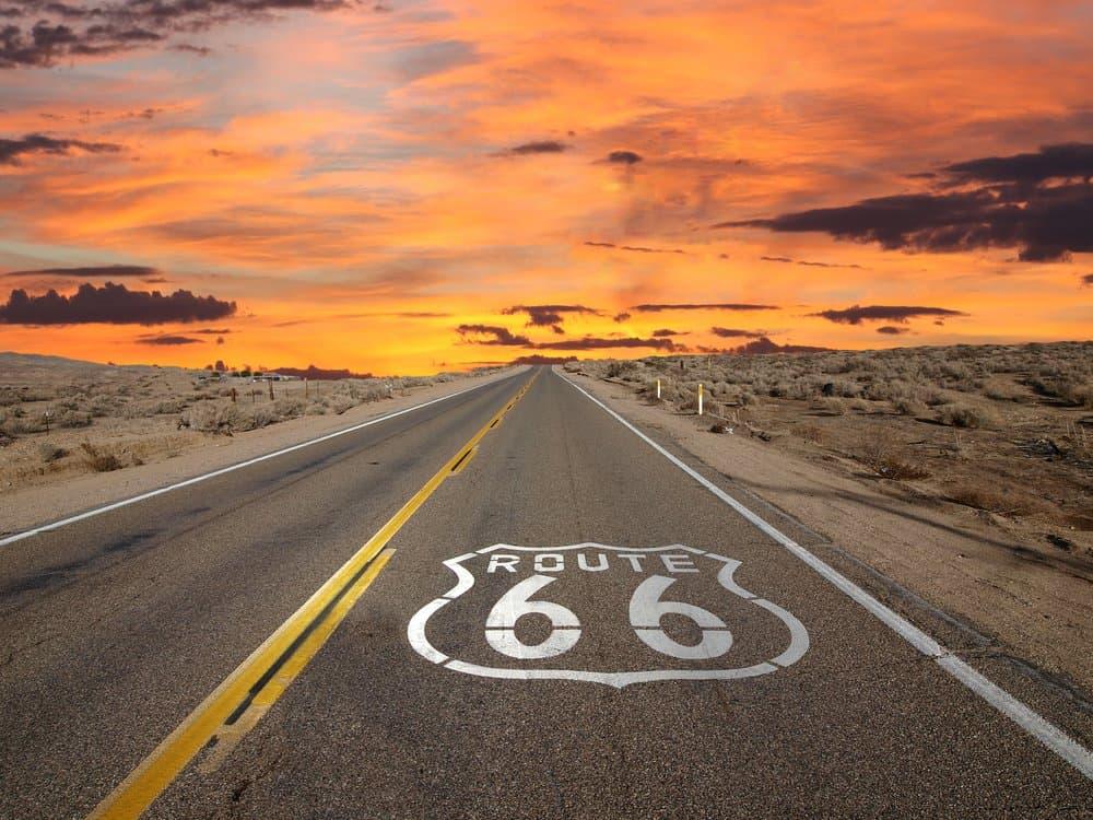 USA - California - Route 66 pavement sign sunrise in California's Mojave desert.