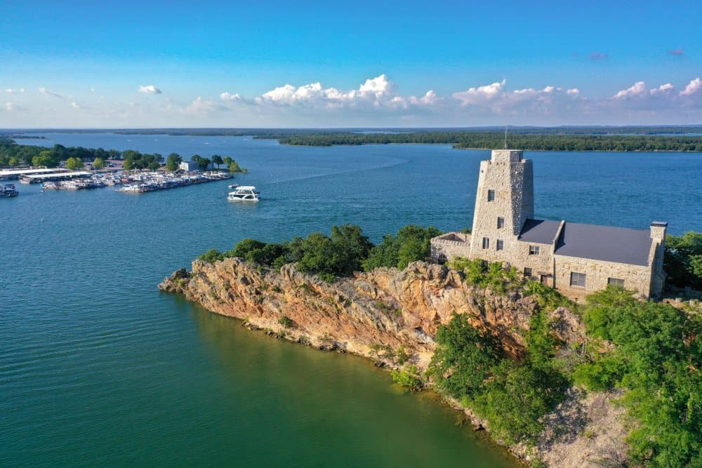 Oklahoma - Aerial view of Tucker Tower on Lake Murray in Ardmore Oklahoma on a summer day with a houseboat in the distance