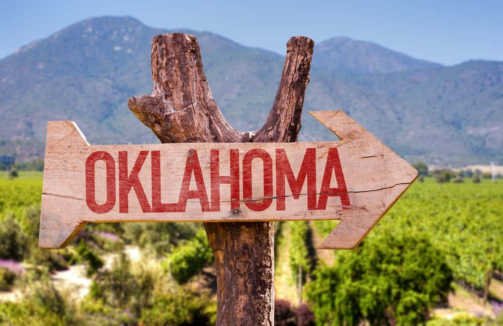 USA - Oklahoma - Oklahoma wooden sign with winery background