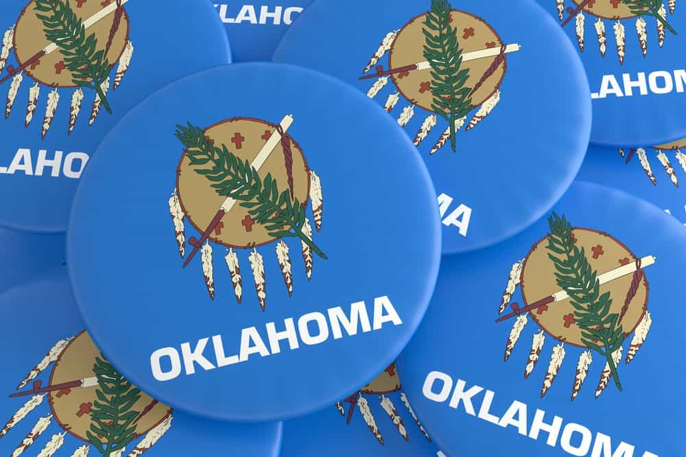 USA - Oklahoma - US State Buttons: Pile of Oklahoma Flag Badges, 3d illustration
