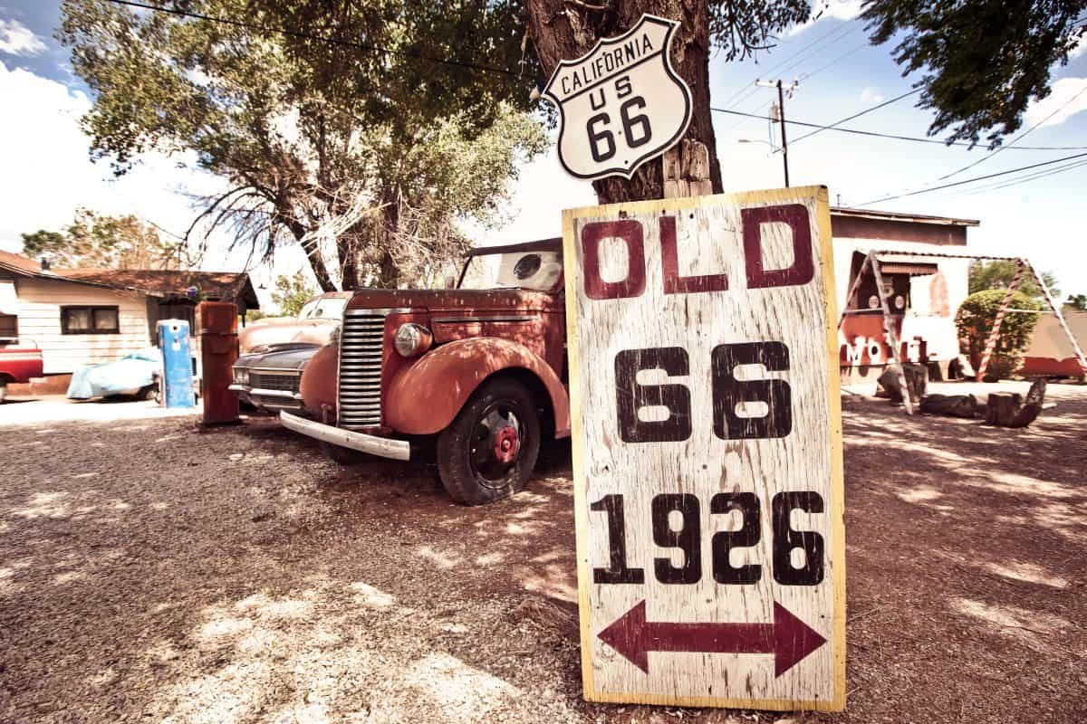 California - Old route 66 signs with rusty cars in background