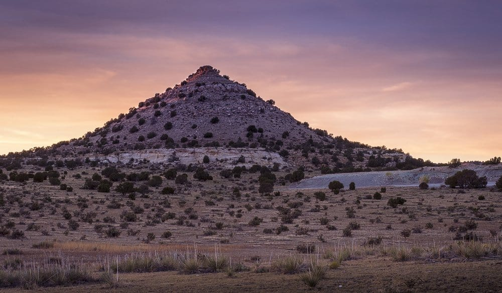 Oklahoma - The sun sets on this pointy mountain/hill near Black Mesa in the Oklahoma panhandle.