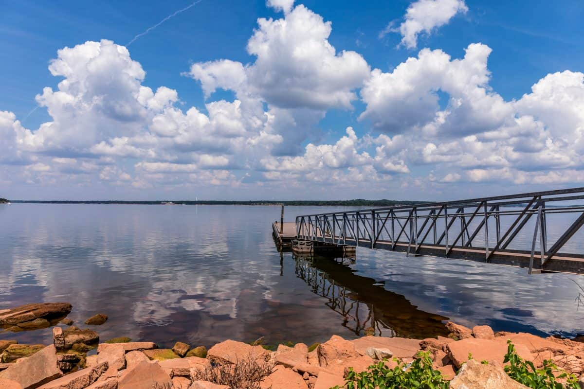 A senic view of the clouds reflecting in the water at Thunderbird Lake in Oklahoma.