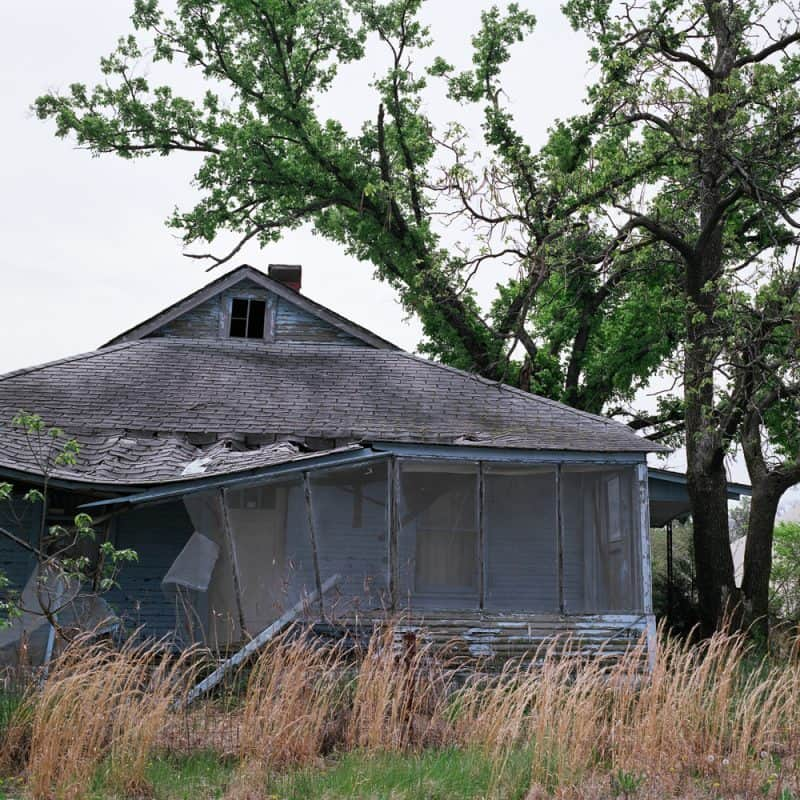 USA - Oklahoam Blue house with broken porch, Picher, OK