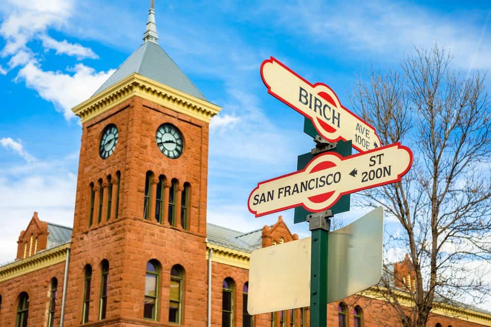 USA - Arizona - Flagstaff - Cityscape view of Birch Avenue and San Francisco street signs with clock tower in Flagstaff, Arizona.