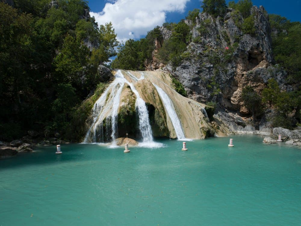 Oklahoma - Beautiful Turner Falls on a bright sunny day. Turner Falls is one of the two Oklahoma's tallest waterfalls.