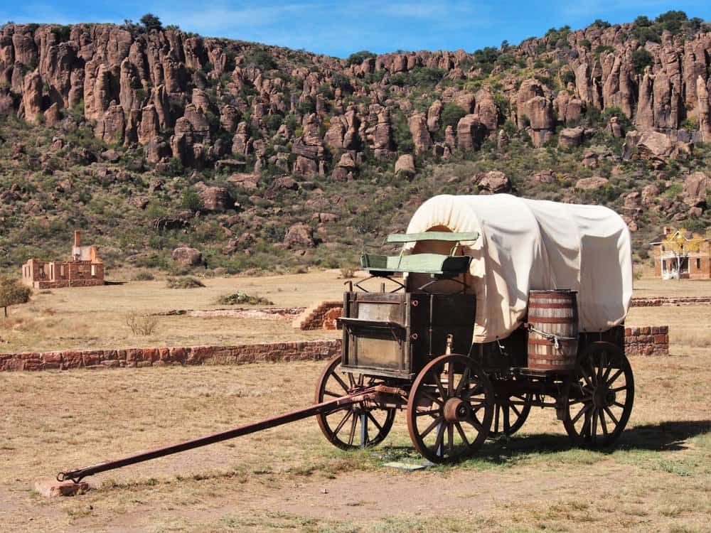 USA - Texas - Old Covered Wagon in the Desert Among the Ruins of Fort Davis, Texas, USA