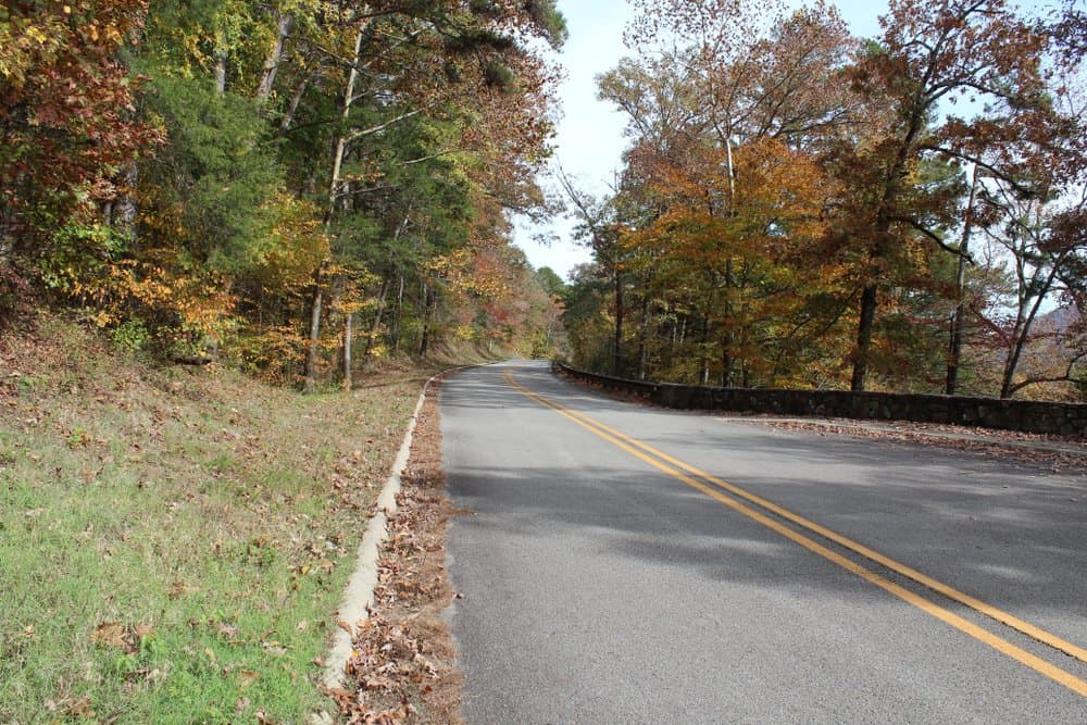 USA - Arkansas - Curvy road in the Ozark Mountains near the pig trail in Arkansas. Fall foliage visible.