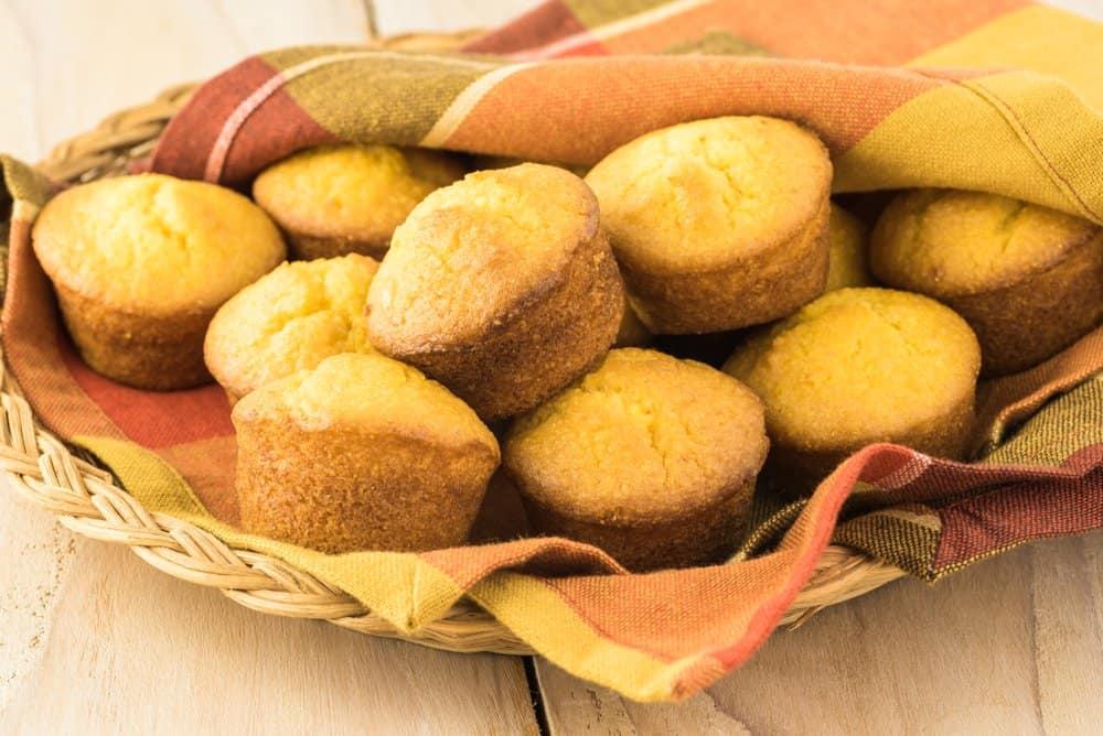 Mini cornbread muffins on a plate.