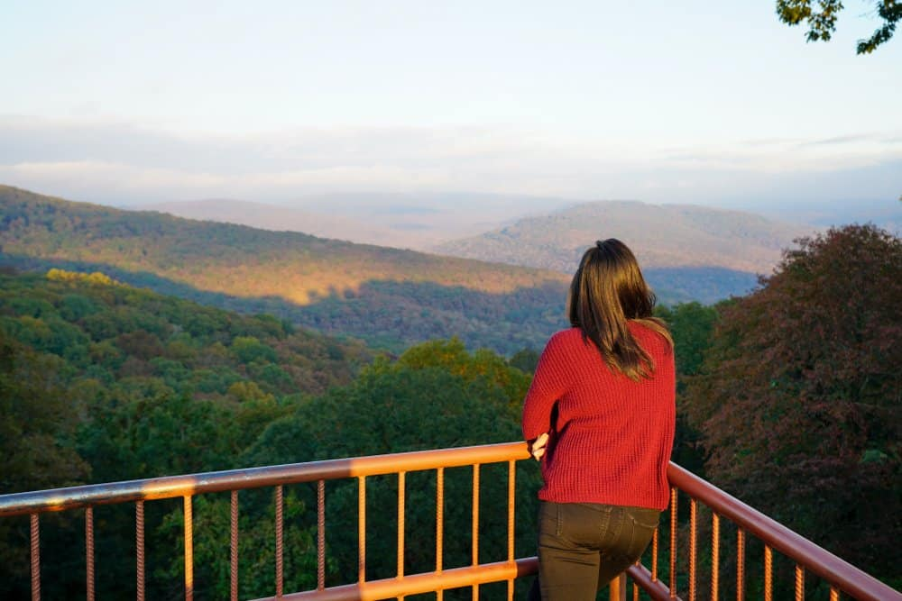 USA - Arkansas - Woman overlooking scenery along Boston Mountains Scenic Loop in Arkansas