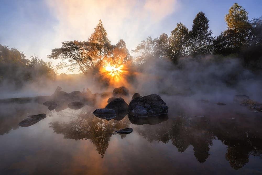 USA - Arkansas - The hot spring with a 73 degree Celsius water spring over rocky terrain. heat from the hot spring providing a misty and picturesque scene which is particular beautiful in the morning at National Park