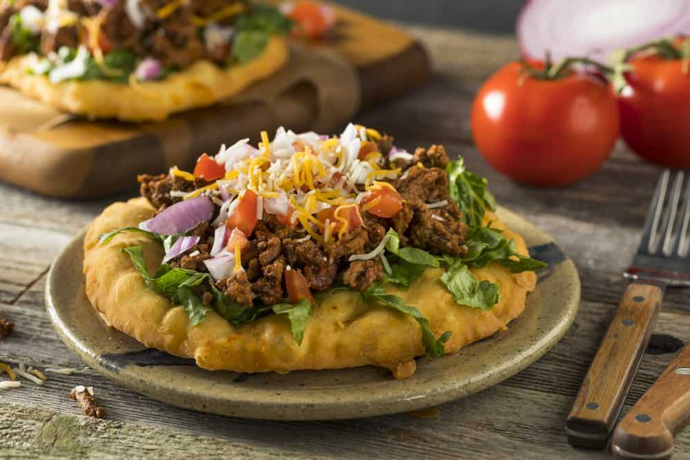 Homemade Indian Fry Bread Tacos with Ground Beef Lettuce and Tomato