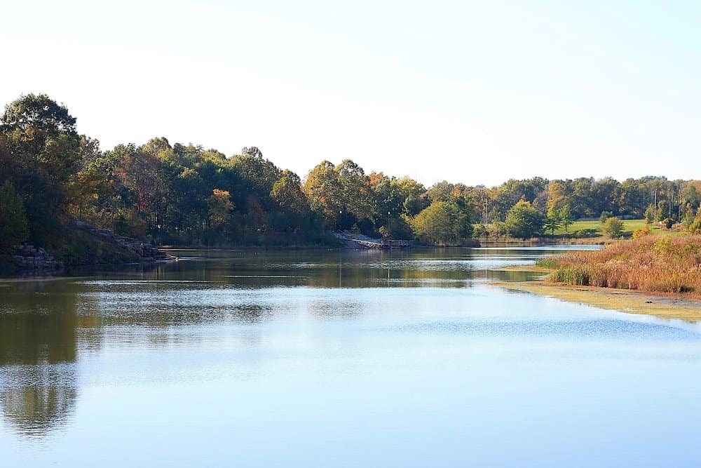 lake scene with foliage in background. Red,orange, yellow, green trees. In Independence, Missouri - a town of Kansas City.