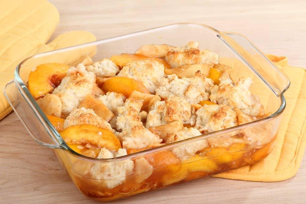 Peach cobbler dessert in a baking dish