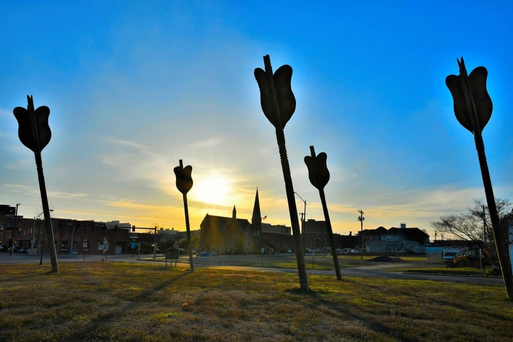 USA - Arkansas - Silhouette of large wooden arrows in downtown Fort Smith, Arkansas arranged in the ground in an artistic fashion and taken near sunset