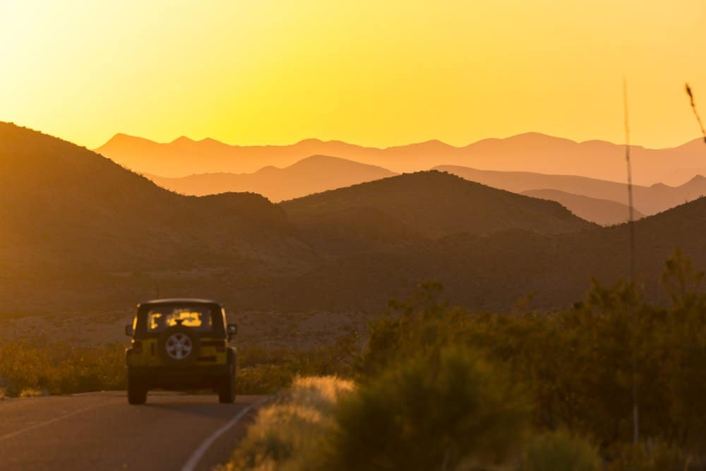 USA - Texas - A car driving down the road in Big Bend National Park during a beautiful sunset in Texas.