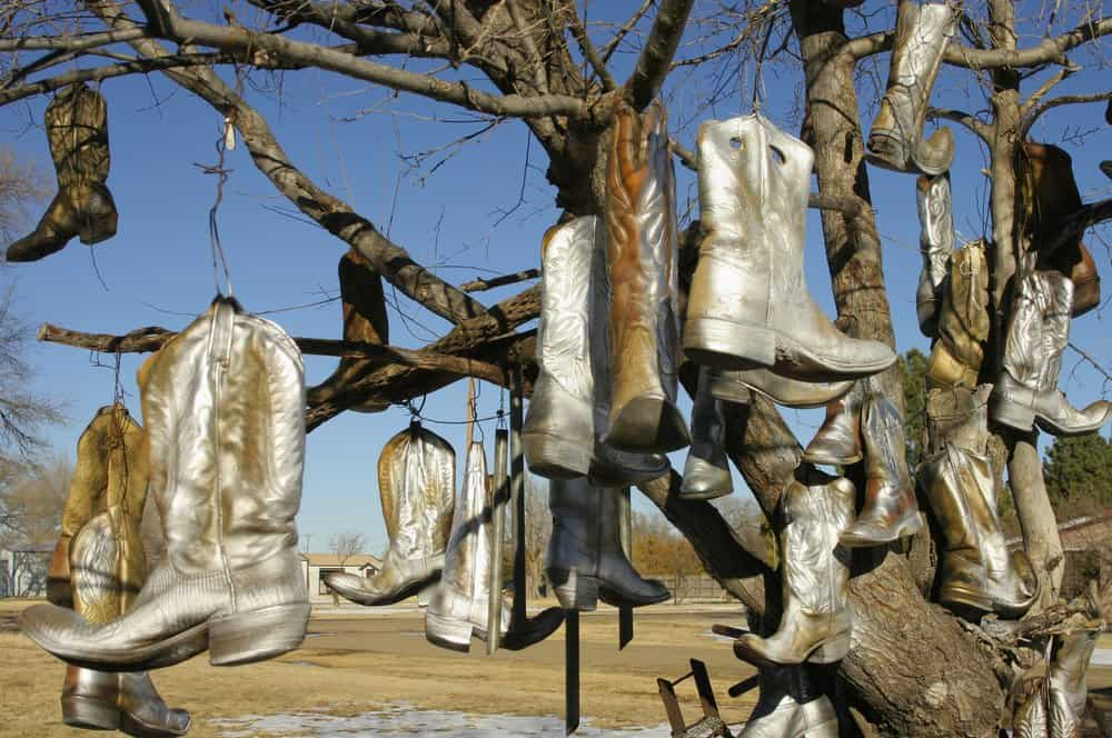 USA - Texas - Old cowboy boots hanging from a tree in Vega, TX on Route 66