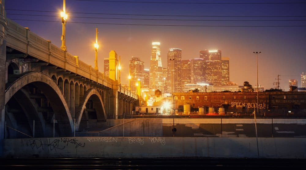 California - City of Los Angeles at night. Scenic view of downtown skyline with bridge in foreground.