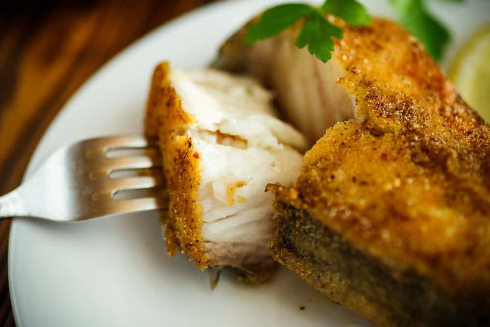 Arkansas - catfish roasted in batter on a wooden table