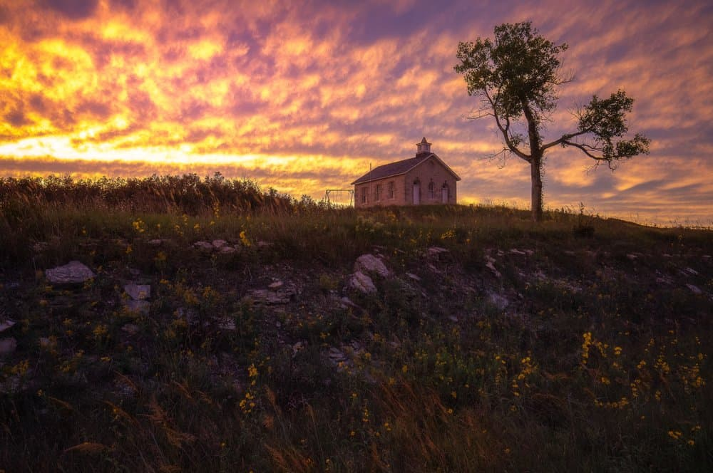 Kansas - Sunset at a historic limestone schoolhouse - Tallgrass Prairie National Preserve