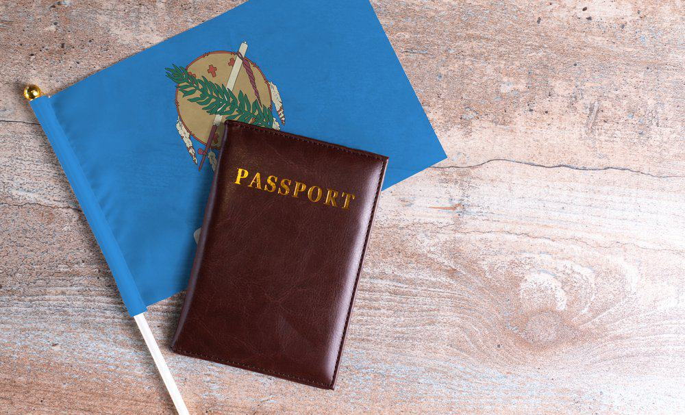 Oklahoma - Passport and a Oklahoma flag on a wooden background. Travel concept