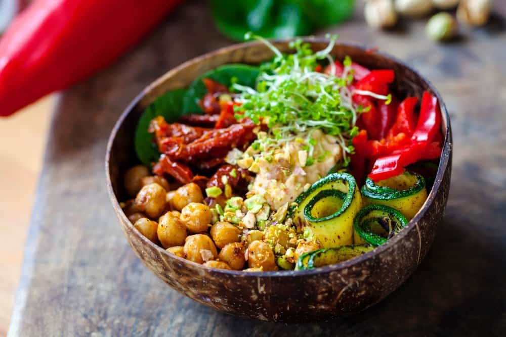 Oklahoma - Tulsa - Vegan Buddha bowl with chickpeas, courgette, sundried tomatoes and sprouts