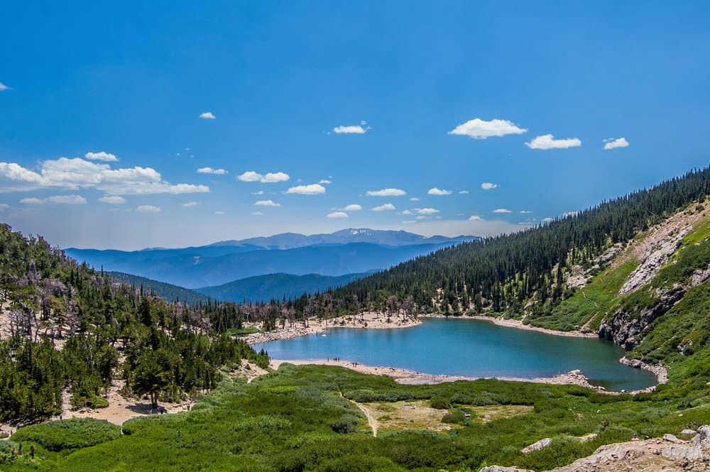 Colorado - Idaho Springs - The lake and woods just below the melting snow of St. Mary's Glacier in Colorado.
