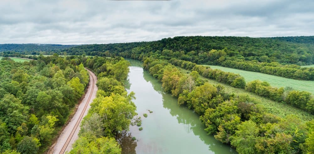 Arkansas - Hardy - Aerial flight over the Spring River next to the BNSF railroad in Hardy, Arkansas