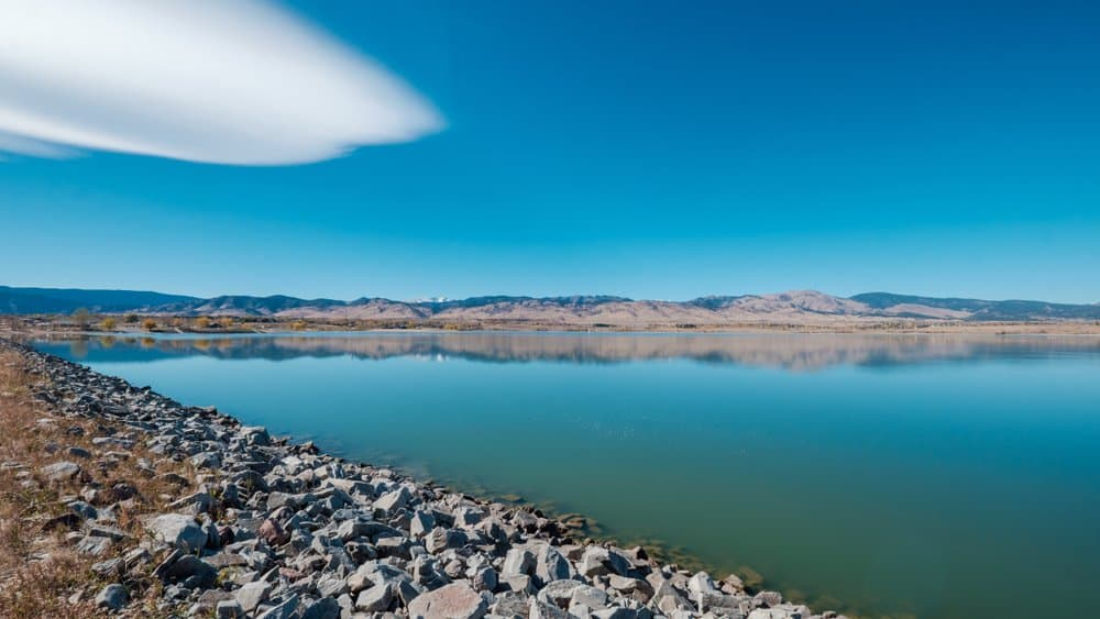 Colorado - Boulder - Colorado Boulder Reservoir with the Rocky Mountain range in the background and as reflected by the vast water body during later autumn.