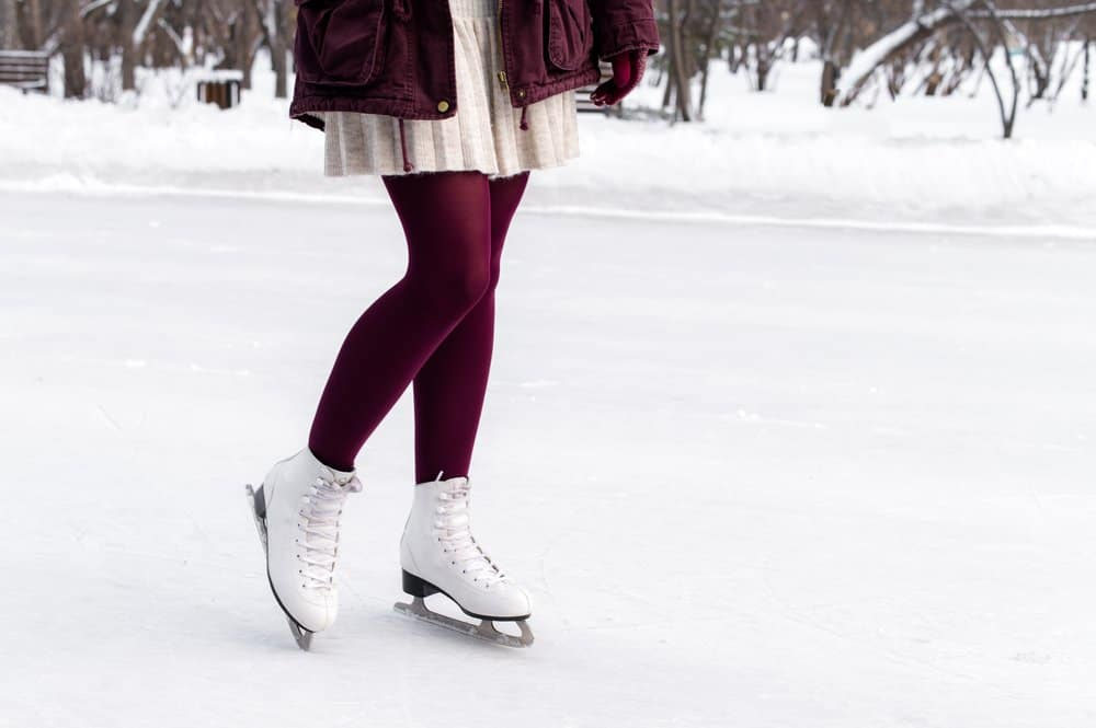 Arkansas - Jonesboro - Close-up of women's legs on skates in winter on an open skating rink. Winter time. Place for text