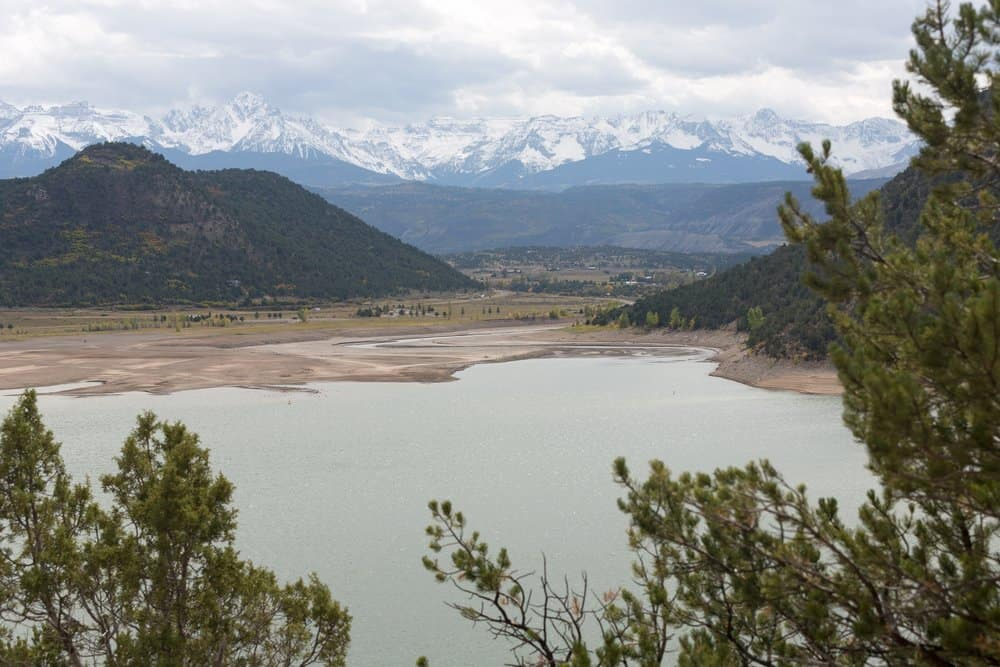 Colorado - Ouray - Ridgeway Reservoir and The Sneffels Range in a bright day light misty cloudy sky as seen from Ridgway State Park near Ridgway, Colorado, USA.