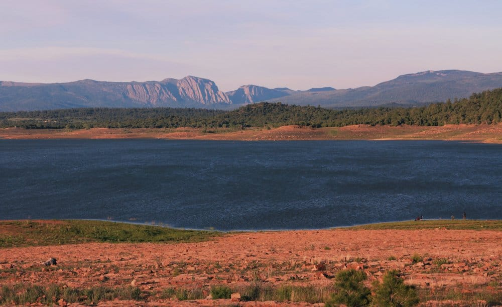 New Mexico - Late afternoon sun settling in over Lake Heron in New Mexico with views of the mountains in the distance