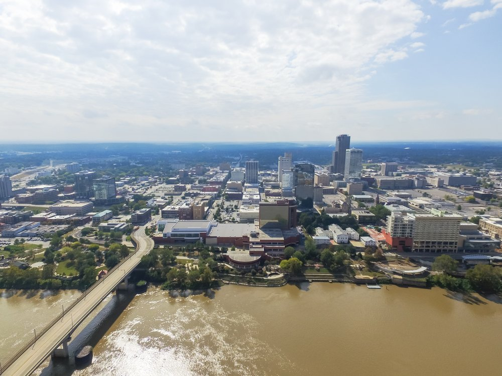 Arkansas - Little Rock - Aerial view downtown Little Rock at the south bank of Arkansas River. Its the capital and most populous city of Arkansas state, US. Main St Bridge and Junction Bridge Pedestrian Walkway across river.