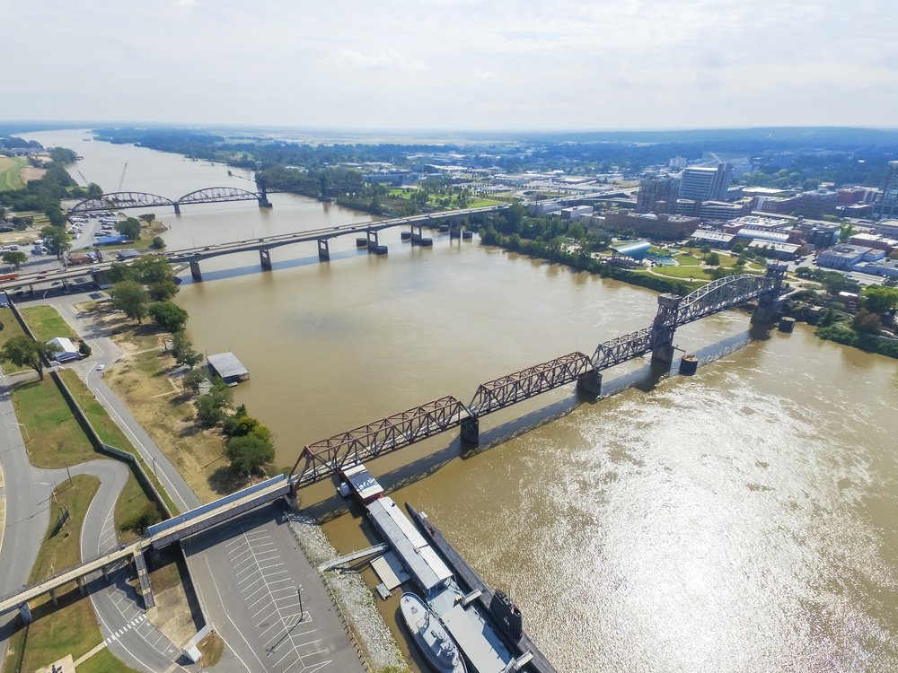 Arkansas - Little Rock - Aerial view Arkansas Inland Maritime Museum with Balao-class submarine along the north side of Arkansas river. Available are Junction Bridge Pedestrian Walkway, I-30 and Arkansas River Trail Bridge.