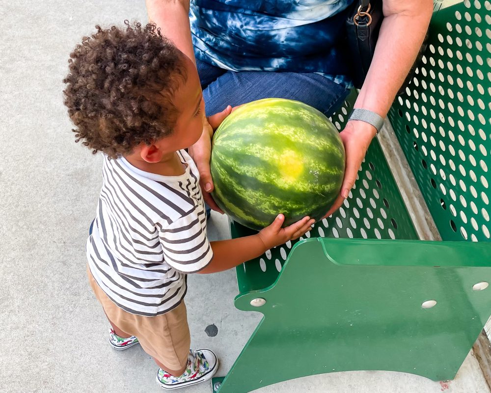 Texas - Luling - Downtown Luling - Jordan and a watermelon souvenir from the Watermelon Thump
